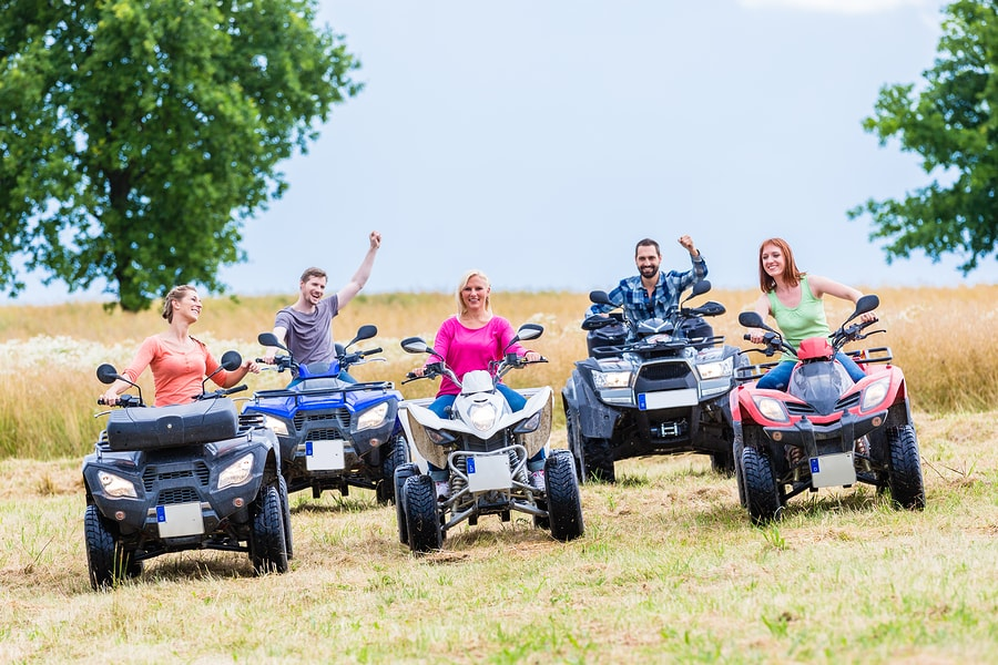A family all on ATVs.